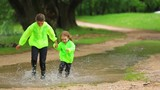 Cute Kids Running In Huge Puddle