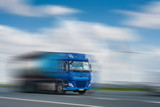 Blue Track in Motion Blur on Highway