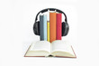 Group of books and headphones related to audio books with isolated background