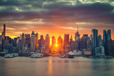 Fototapety Cloudy sunrise over Manhattan, New York