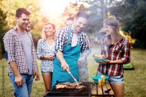Zdjęcia na płótnie, fototapety, obrazy : Friends camping and having a barbecue