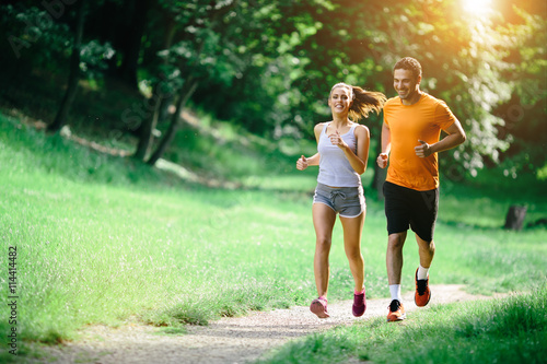 Deurstickers Jogging Healthy couple jogging in nature