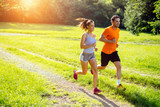 Fototapety Athletic couple jogging in nature