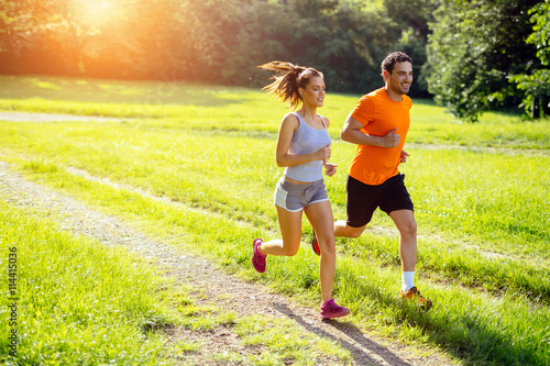 Athletic couple jogging in nature