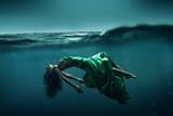 Woman floating underwater - 114416821