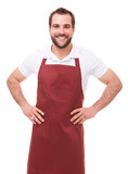 Smiling man with red apron