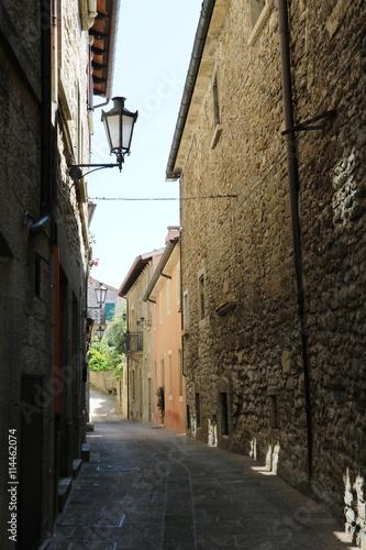 Narrow alley in San Marino under blue sky