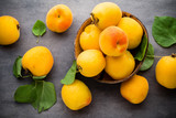 Apricots on a grey metal background.