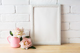 Fototapety White frame mockup with two pale pink roses
