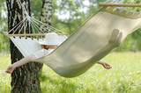 Woman resting in hammock. - 114481643