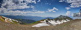 Russia, Sochi, 21 June 2016: Summer Panorama of mountains from Roza Pik 2320, an observation deck, the top point of ski slopes on Krasnaya Polyana to Sochi, the snow remains on slopes, stones, snow