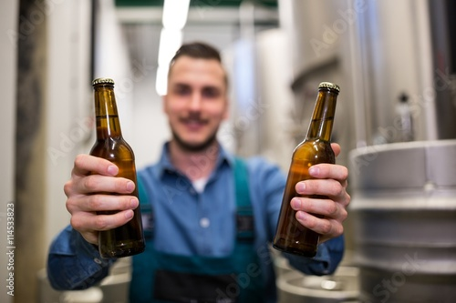 Fotografiet Brewer holding two beer bottle