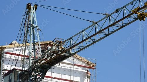 Foto op Canvas Canada Construction cranes over houses.