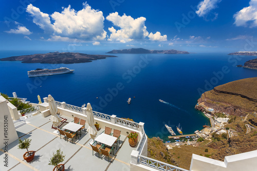 Zdjęcia na płótnie, fototapety, obrazy : Greece. Cyclades Islands - Santorini (Thira). Fira town (the modern capital of island) with characteristic style for Cycladic architecture. There are islands: Nea Kameni and Thirasia in the background