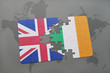 puzzle with the national flag of great britain and ireland on a world map background - 114554253