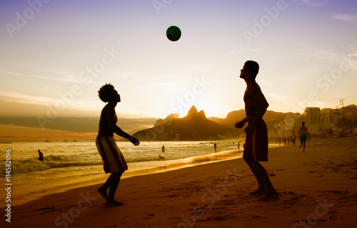 Obraz na plátně Two guys loves playing soccer at beach at Rio de Janeiro