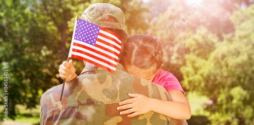 Army man hugging daughter with American flag Poster
