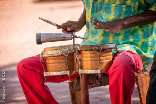Street musician playing drums in Trinidad, Cuba - 114597827