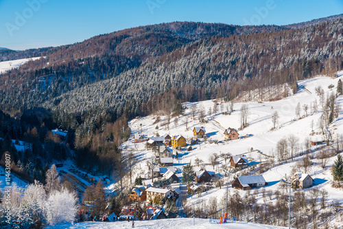 View of Wierchomla village from ski slope, Beskid Sadecki Mountains, Poland