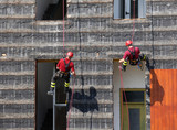 climbers of firefighters climbing a wall of a house during the f