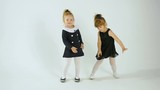 Cute Little Girls Dancing And Having Fun, Isolated On White Studio Shot