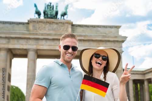 Poster Happy Couple Holding German Flag