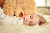beautiful girl dreaming with teddy bear, toned image