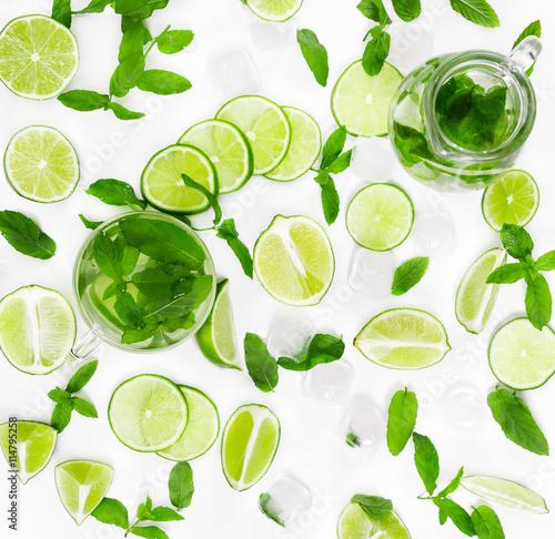 Fototapeta Limes, fresh mint and ice for mojito
