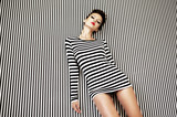 fashion woman in striped dress on  background