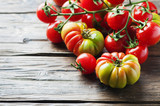 Sweet italian tomatoes on the wooden table