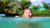 woman in a bathing cap swim in the swimming pool.