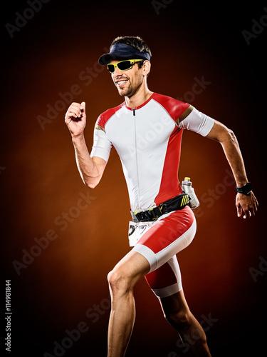 Fototapeta man runner running triathlon ironman isolated