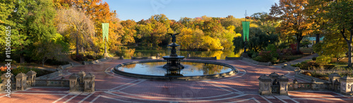 Sunrise in Central Park at Bethesda Fountain with The Lake and colorful Fall foliage. Panoramic view of the Bethesda Terrace, Manhattan, New York City