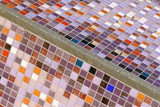Detail of a beautiful old crumbling abstract ceramic mosaic - 115009824