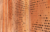 Rusty metallic background with holes - 115011841
