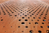 Rusty metallic background with holes - 115011860