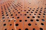 Rusty metallic background with holes - 115011872