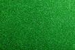 Artificial turf. Studio shot. Green background. Copy space.