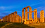 old Roman Aqueduct of Merida in evening