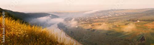Fototapeta Summer foggy morning on the river in canyon