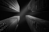 Fototapety Architectural fine-art black and white photograph with four New York skyscrapers converging towards the sky
