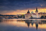 Prague. Image of Prague riverside and Charles Bridge, with reflection of the city in Vltava River.