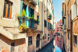 Scenic canal with colorful buildings in Venice, Italy