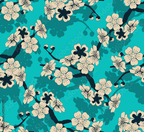 Cotton fabric a Japanese style seamless tile with a cherry tree branch and flowers pattern in ivory and blue shades