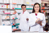 Portrait of two friendly pharmacists working