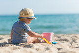 Boy playing with toys on beach