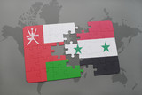 puzzle with the national flag of oman and syria on a world map background.
