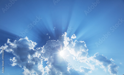 Sun slanting among from white clouds. - 115123648