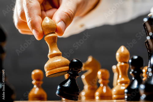 Poster, Tablou Hand of businessman playing chess