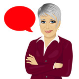 attractive senior businesswoman with arms folded standing near red blank speech bubble
